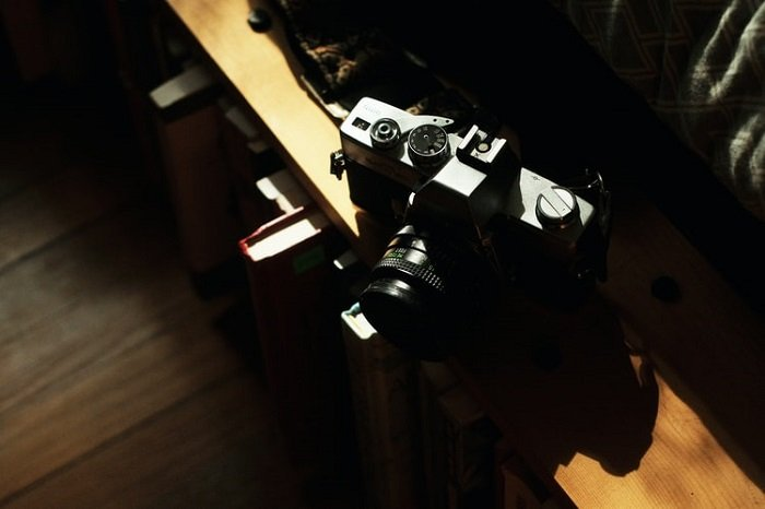 Dark image with a DSLR camera placed on a table