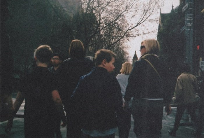 film grain on an image of a street with pedestrians