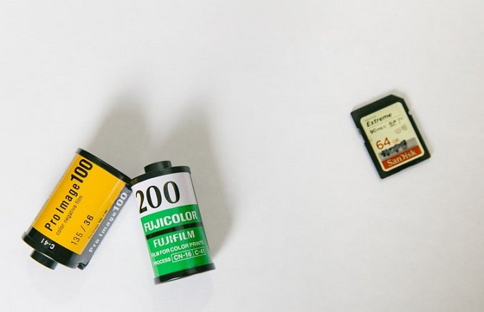 two film rolls compared to a SD card