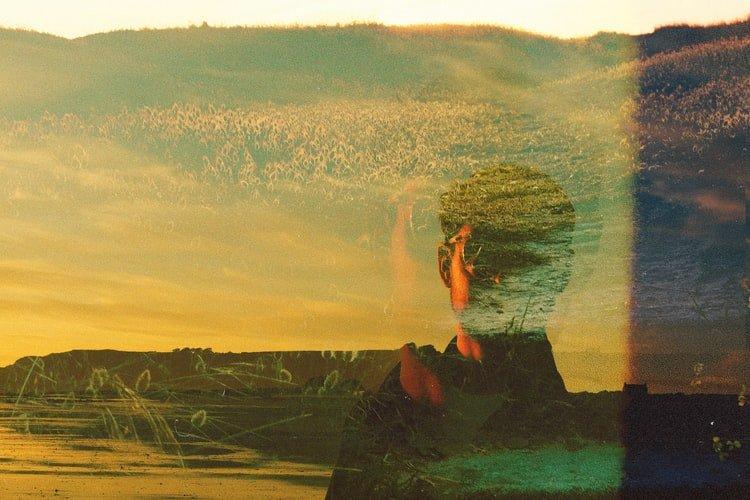 double exposure of a portrait and landscape