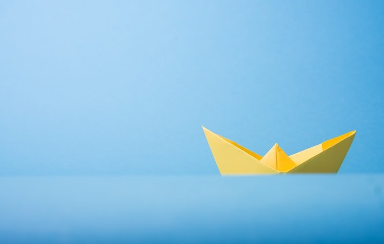 minimalist image of a paper boat