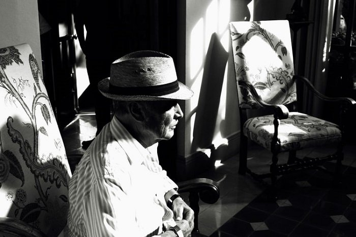 portrait of an old man in black and white