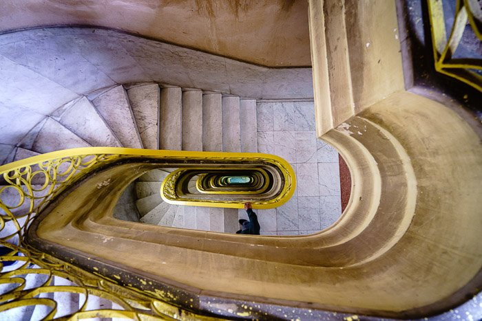 Color Image of a spiral staircase shot from above before photoshop selective color