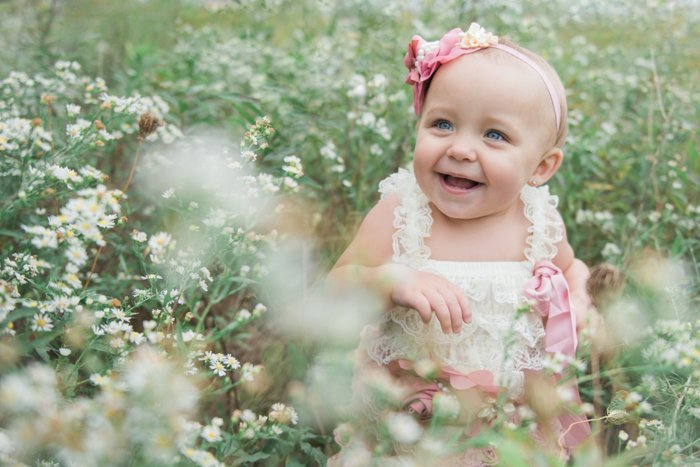 happy child sitting in a meadow