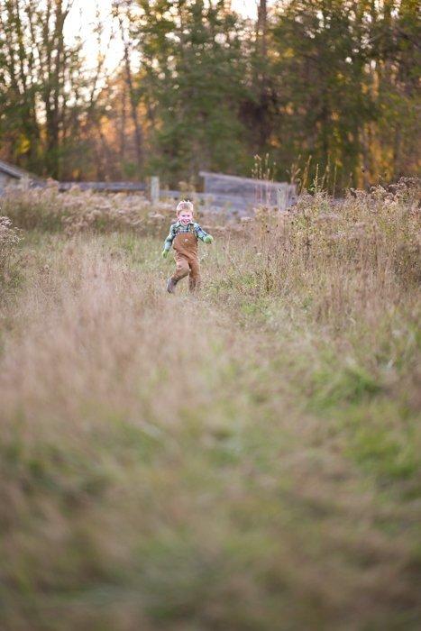 dynamic shot of a child running through a field
