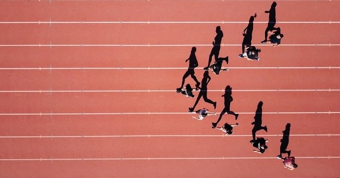overhead shot of runners on a track