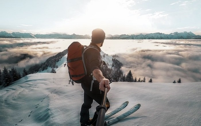 panoramic view of a skiier on a snowy mountain slope taken with a 360 camera