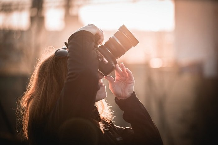woman shooting with a DSLR
