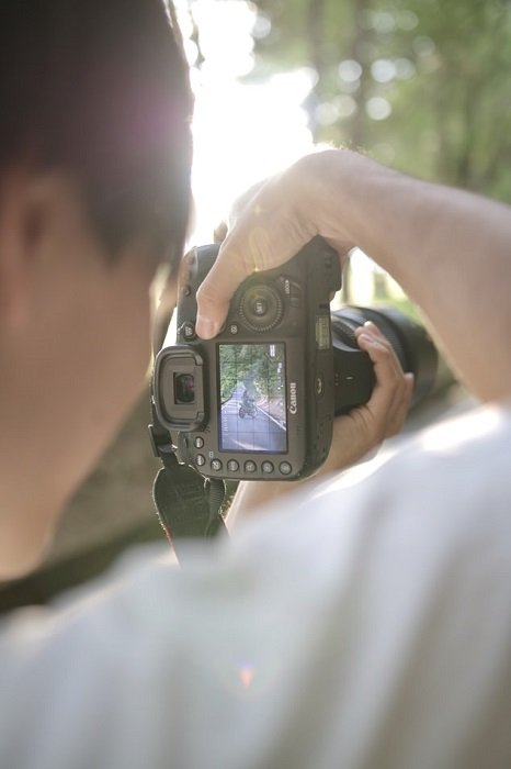 image of a man shooting with a Canon camera