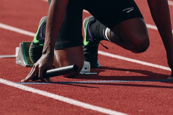 sports image of a runner taken on a running block using a telephoto lens