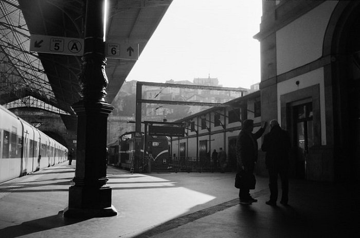 black and white photograph of a train platform