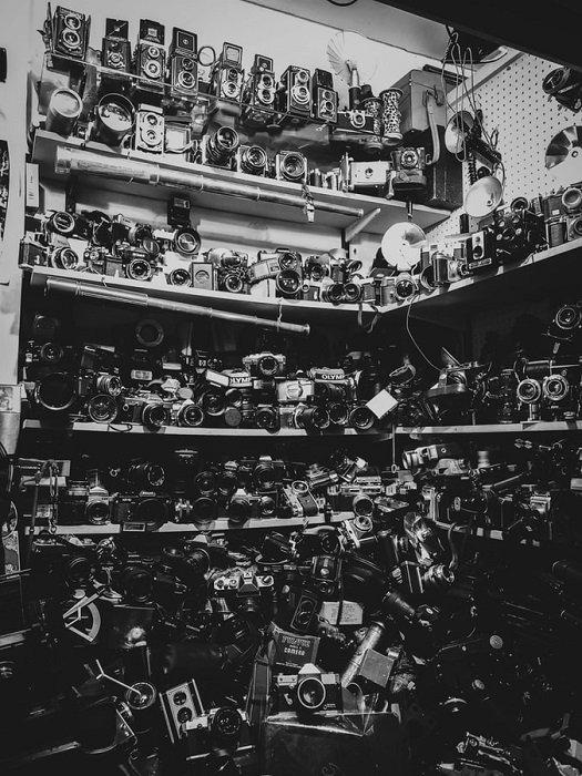 shelves full of film cameras taken on black and white films