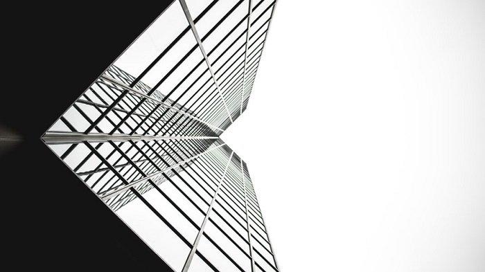 black and white film processing of a glass skyscraper