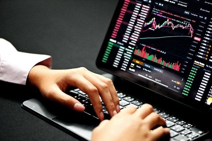 stock market analysis on a laptop screen