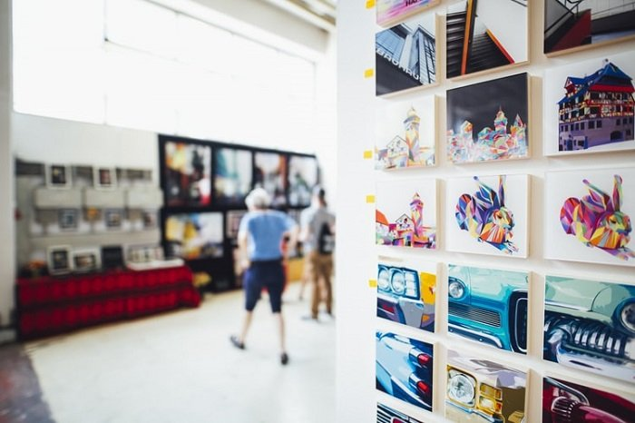 art gallery with graphic images in the foreground and blurry background