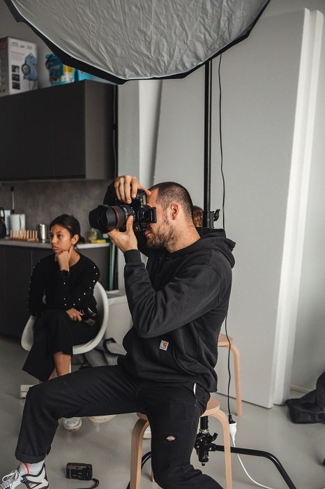 a professional photographer taking a photo in a studio