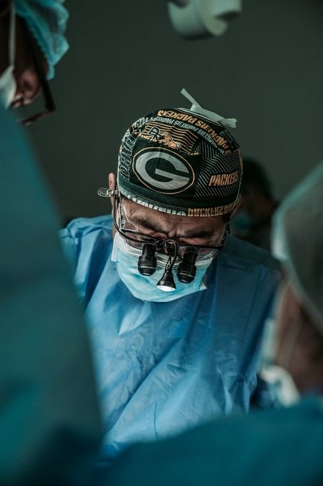 photograph of a surgeon in an operating room