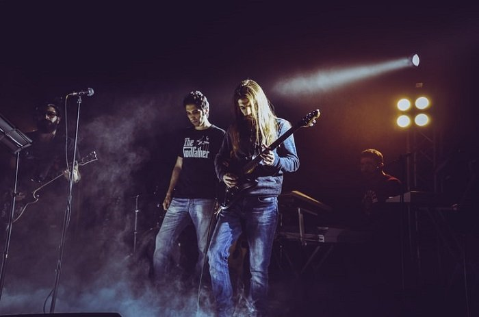 atmospheric image of a band performing on stage