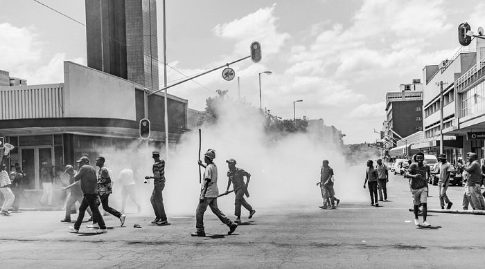 black and white photo of a street protest