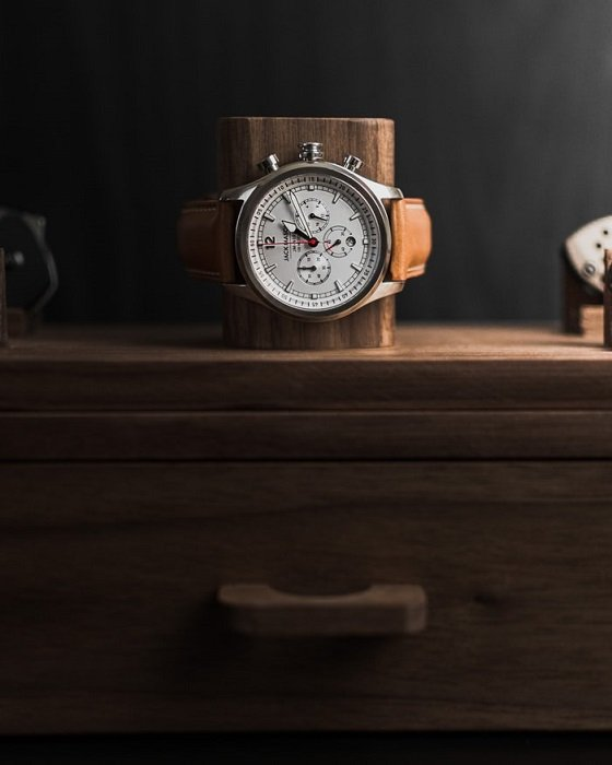 product photo of a watch on a wooden stand