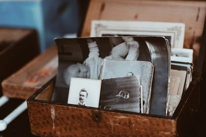 wooden boxed with old photographs and polaroids saved as mementos