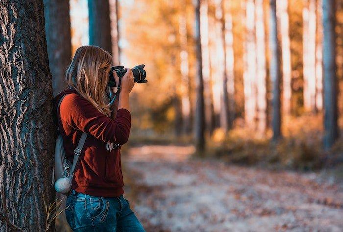 female photographer with sleek camera bag