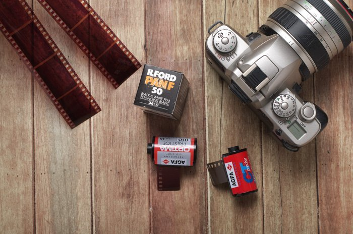 photograph of a camera with rolls of film