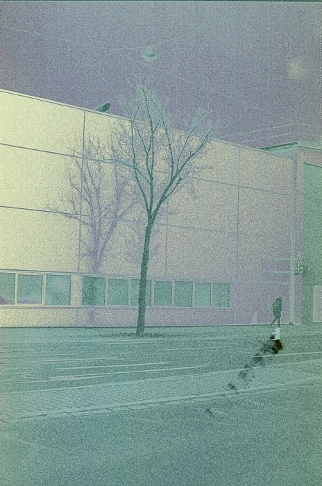 street captured on expired film with a green hue and high film grain