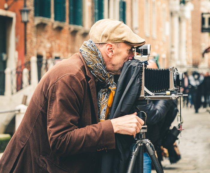 photographer with film camera