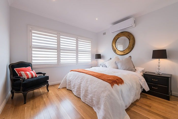 A bedroom interior with hardwood floor shot for real estate photography