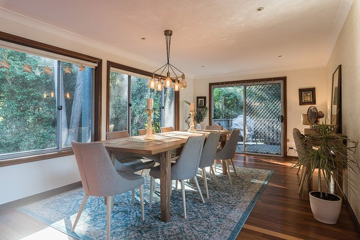 A dining room interior with big windows shot for real estate photography