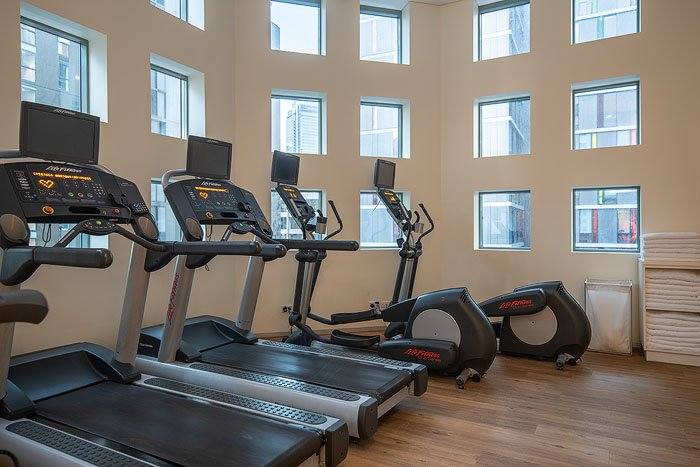 Exercise machines in the interior of a gym shot for real estate photography