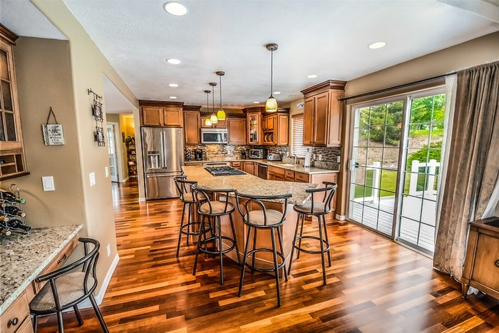 Kitchen interior with wood flooring and cabinets shot for real estate photography