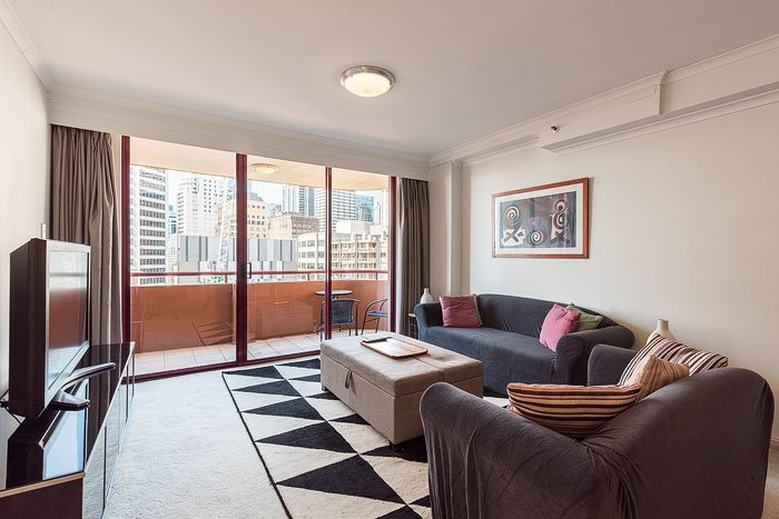 A living room interior with a balcony and a city view shot for how to get into real estate photography