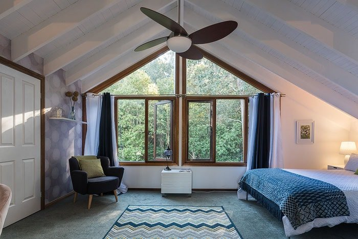 A casual bedroom loft interior with window and a-frame shot by a real estate photographer