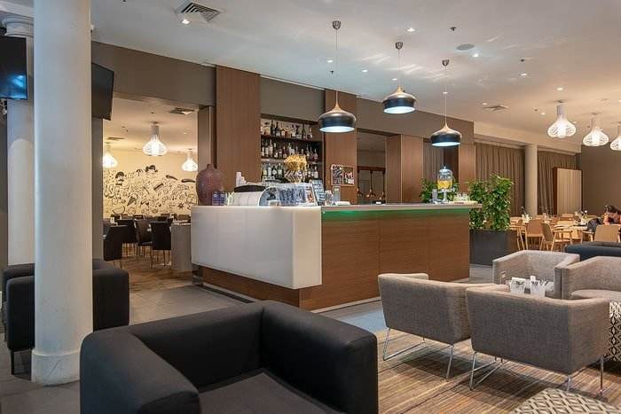 Wide angle image of a hotel bar interior shot for how to get into real estate photography