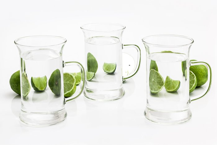 Limes refracted by glass pitchers of water demonstrating diffraction in studio light