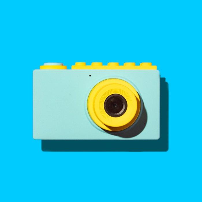 A camera against a blue background