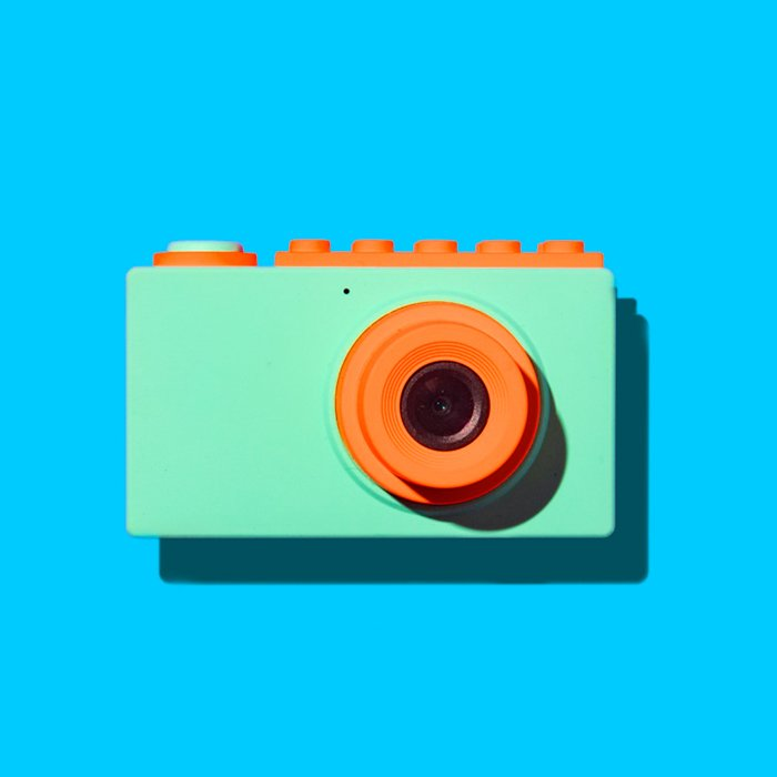 Orange and Seafoam green camera against a blue background