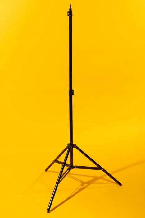 Light stand against a yellow background
