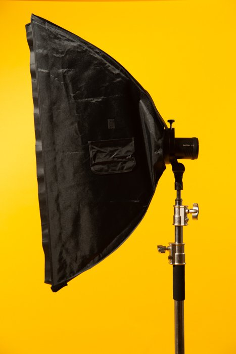 Stripbox against a yellow background