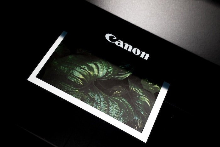 Printed enlarged photo coming out of a Canon printer