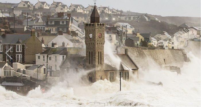storm waves crash near an old city- landscape photography