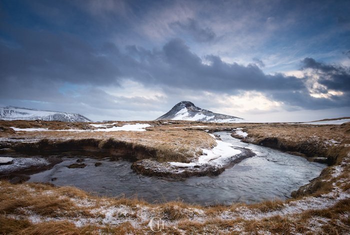 slow moving river flowing through a winter landscape