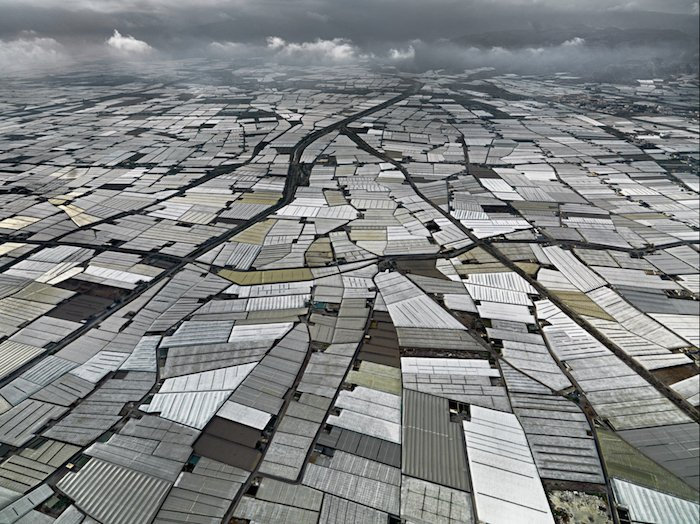 interesting composition for aerial landscape photography: aluminum rooftops for as far as the eye can see