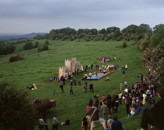 photo of a group gathering on a green grassy field