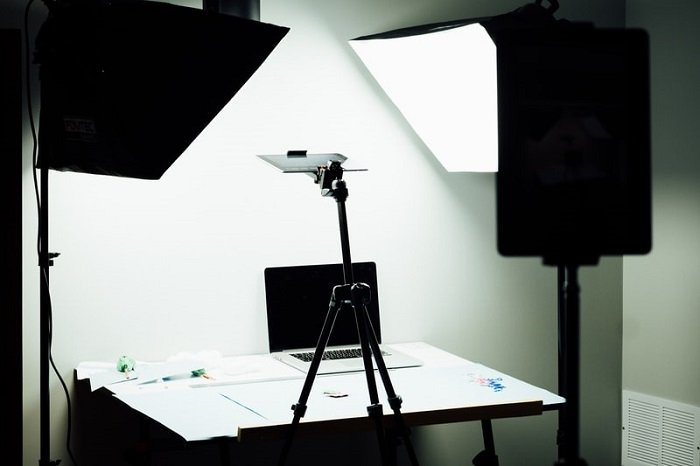a behind the scenes shot of a miniature photography desk setup