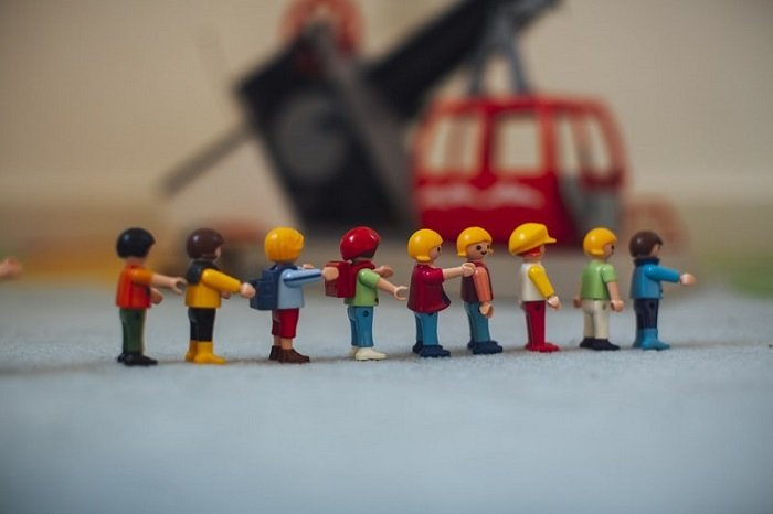 miniature photography of figures in a line