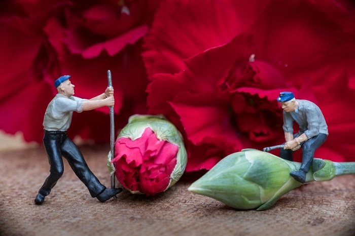 miniature photography of two workers