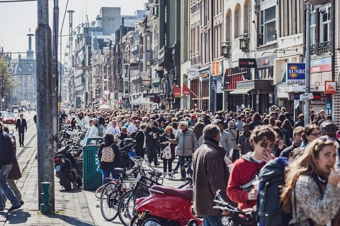 image of a street crowded with pedestrians